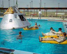 Prime crew members announced by the National Aeronautics and Space Administration (NASA) for the first manned Apollo 1 space flight practice water egress procedures in a swimming pool at Ellington Air Force Base (EAFB), Houston, Texas. Astronaut Edward H. White II rides life raft in the foreground. Astronaut Roger B. Chaffee sits in hatch of the boilerplate model of the spacecraft. Astronaut Virgil I. Grissom, third member of the crew, waits inside the spacecraft. Print of this photo is…