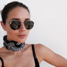 Neck scarves are officially the new statement necklaces. Here are 13 street style stars to show you how to tie a neck scarf like a pro.