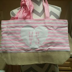 Large Victoria's Secret Pink and White Tote. NWOT Large Victoria's Secret tote! Pink and white stripes with detachable scarf. NWOT. Victoria's Secret Bags Totes