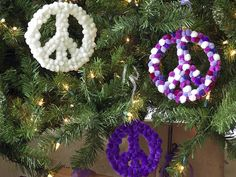 Peace signs in bold colors give the Christmas tree a fun and funky feel. This is a great project to make with the kids. >> http://www.diynetwork.com/decorating/how-to-make-retro-christmas-decorations/pictures/index.html?soc=hpp