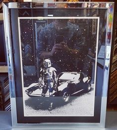 With the new Star Wars trailer premiering last week, we couldn't resist sharing this Limited Edition print of Boba Fett and a Corvette framed using a metallic black acid-free mat, conservation glass, and Harlow frame by @larsonjuhl! Custom framed by FastFrame of LoDo. #art #pictureframing #customframing #denver #colorado #starwars #bobafett