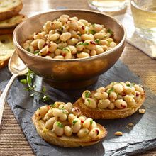 GOYA® Low Sodium White Beans are sautéed with olive oil, lemon juice, garlic and other herbs and spices. The result? A delicious topping for crunchy garlic-rubbed toasts.