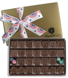U.S. Air Force Above All, with airplane icons, and decorative foil-wrapped patriotic and earth chocolate balls, and your choice of hand-tied ribbon.