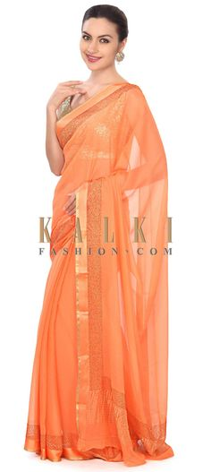 Buy this Orange saree highlighted in kundan border only on Kalki