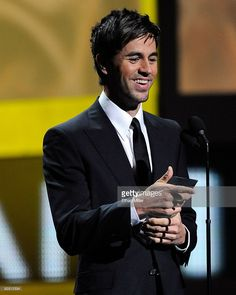 Singer Enrique Iglesias presents the Person of the Year award onstage during the 10th annual Latin GRAMMY Awards held at Mandalay Bay Events Center on November 5, 2009 in Las Vegas, Nevada.
