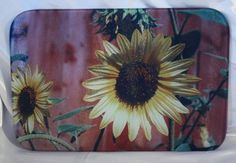 Glass Cutting Board with photo of Sunflower against by TreeSqueaks, $25.00