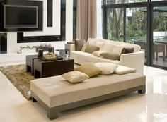 Large airy beige and white modern living room design