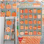 Heres a better shot of the pumpkins quilt  You knowsince you need another project to squeeze in this month  I used basic orange prints so I can leave this out until Christmas  Pattern is in the shop  link in profile Thanks for letting me steal your mosaic trishpoolson