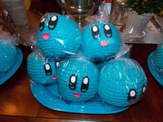 Kirby yarn ball party favors (purchased the yarn balls from Etsy vendor and added the felt faces and feet)