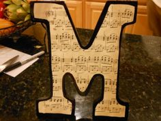 "DIY Wall Art: Block letters with ""antique"" sheet music -- would be a great last minute Christmas gift for someone!"