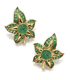 PAIR OF 18 KARAT GOLD AND EMERALD EARCLIPS, RENÉ BOIVIN, FRENCH, CIRCA 1940. The stylized foliate motifs set in the center with 2 round cabochon emeralds, further enhanced with numerous calibré-cut emeralds, maker's mark RD in a lozenge for Davière, French assay  marks.