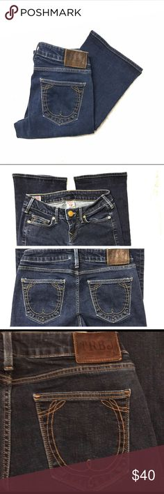 """True Religion Brand Jeans True Religion Brand Jeans, size 25, dark wash, leather brand patch at back waist, 92% cotton, 6% polyester, 2% spandex.  Measurements laying flat, 13"""" waist, 32"""" length, 7"""" rise, 7.5"""" leg opening. True Religion Jeans"""