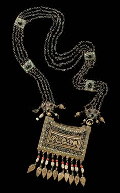 """Uzbekistan   Necklace with amulet case """"bazband""""   silver, gold plated, decorated in Niello techique, turquoise, coral, mother of pearl beads   ca. Late 19th century   Est. 1900 - 3800€"""