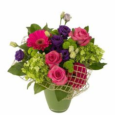 Radiant Beauty - With its intense colours, this design really catches the eye. Green Hydrangea, Mesh Ribbon, Gerbera, Floral Arrangements, Hot Pink, Floral Wreath, Colours, Rose, Plants