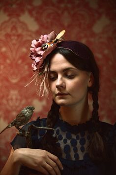 floral headpiece and a little bird