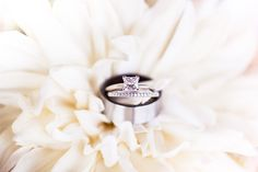 GORGEOUS! We love this square solitaire diamond engagement ring with diamond wedding band! Kadee's Approach Photography paired the sparkling rings against a soft romantic flower. Click the image to learn more. Photo credit: Kadee's Approach Photography