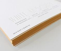 """Simple, elegant, these vintage-inspired, Lettra-printed invites by Sideshow Press make us want to put on something sparkly. Here's a little about them: """"Inspired by the movie White Mischief set in the 1940's, Sideshow designed and printed these mysterious invitations. These square invitations were 2 color letterpress (blind + black) on 220 Crane Lettra Paper and then edged in a mustard yellow. We love the simplicity and style of these vintage inspired invitations."""""""