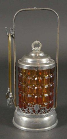 Victorian pickle castor with an amber pattern jar with tongs and carrier.