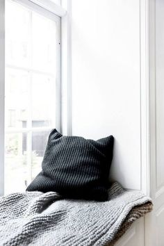 Scandinavian minimal window seat nook | Image by Norm Architects