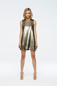The perfect sequin party dress. - Pewter sequin tank dress with laser cut scalloped hem. - Lined in chiffon.