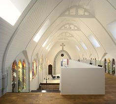 a church turned chic/modernist home. so glad they kept the stained glass windows!