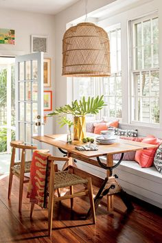 Bright Breakfast Nook - 10 Colorful Ideas for Small House Design - Southernliving. Avoid unused space in a formal dinning room that no one dines in by creating an eat-in kitchen. Turning the former dining area into the living room and opening it up to the kitchen gave the Wallace's space to design a bright breakfast nook. They surrounded a one-of-a-kind kitchen table with two chairs and a built-in bench with lift-up seats for extra storage.