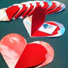 Last Minute Preschool Valentine's from The Peanut's Paintings: water color on bristol board cut into heart, red card stock heart printed with message, and sticker sheet all sewn together on machine (will use silver pen to address closed red heart-half to individual classmates)