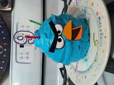 Angry birds cake! Get one of those large cup cake, cake pans bake the cake and color white icing any color you want the bird, Print out the face off the computer and put it on the cake.. So quick and easy