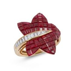 VAN CLEEF & ARPELS. An invisibly-set ruby and diamond 'Forêt' ring