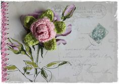 crochet rose on art journal. Lovely!