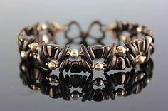 Beaded bracelet with crescent, nib-bit and two hole barshttps://www.sashe.sk/kacenkag/detail/mesacna-vlnka-hneda