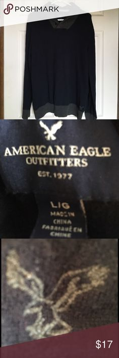 AMERICAN EAGLE OUTFITTERS SWEATER..COOL COLLAR 🌺...AMERICAN EAGLE OUTFITTERS SWEATER WITH A COOL FOLDED COLLAR AND BUTTON.  The eagle emblem is gray on the left bottom.  Navy blue accented with gray.  Worn very little, just a few times.  PERFECT CONDITION!!  Stored in a smoke free home. American Eagle Outfitters Sweaters