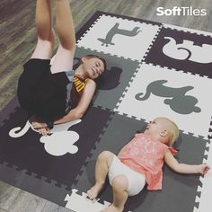 """""""Working on my yoga with big bro"""" SoftTiles Safari Animals Foam Play Mat in black, gray, white. Perfect for cushioning hard wood, concrete, and tile floors."""