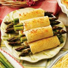Asparagus Appetizer Roll-ups: 12 slices white bread, crusts removed  1 container (8 ounces) spreadable cream cheese  2 tablespoons chopped green onions  8 bacon strips, cooked and crumbled  24 fresh asparagus spears, trimmed  1/4 cup butter, melted  3 tablespoons grated Parmesan cheese  *Directions:   Flatten bread with a rolling pin. In a small bowl, combine the cream cheese, onions and bacon. Spread mixture over bread slices. Cut asparagus to fit bread; place two spears on each bread…