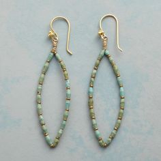 "TURQUOISE TRACERY EARRINGS -- Turquoise beads and brass accents trace a lovely line in marquise earrings perfect year round. 22kt gold vermeil wires. USA. 2-5/8""L."