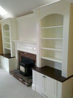 fireplace with hearth bench seating and shelving on each side | Fireplace Built-ins