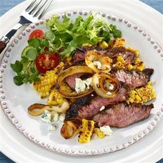 Marinated Hanger Steak with Grilled Onions, Sweet Corn and Blue Cheese. #recipe