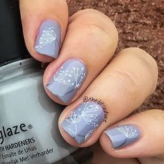 Whimsical nails using @chinaglazeofficial Pelican Gray stamped with @konad_art white stamping polish and @mpolishes Iron using @bundlemonster plate BM 706