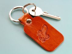 Know someone who really loves eagles? This handmade leather keyring would make an excellent leather gift for dad. This leather keychain for men would also make a great anniversary gift. Check out my Etsy shop! Leather Keyring, Leather Gifts, Handmade Leather, Leather Anniversary Gift, Great Anniversary Gifts, Handmade Father's Day Gifts, Handmade Christmas Gifts, Gifts For Husband, Fathers Day Gifts
