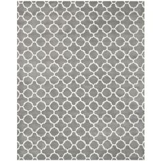 With a thick, dense pile for a luxurious feel, this gray handmade rug offers an eye-catching accent piece to complete your room's decor. Constructed out of durable wool, this contemporary rug features a geometric pattern for a touch of modern elegance.