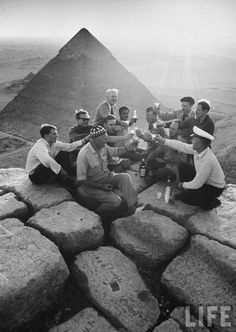 Party at the summit of a pyramid by life magazine 1940's.