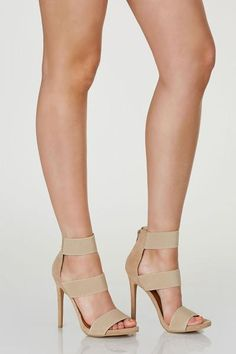 Sexy pair of three band pumps with soft contrast suede exterior. Back zip closure with curved pointed toe finish.