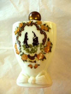 This looks like its probably an old Avon perfume bottle, but it isnt marked, so I cant be sure. On Etsy at RetroRosiesVintage