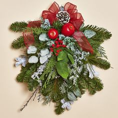 """16""""H x 14""""W Teardrop Pine Swag with Red Apples, frosted greens, Pine Cones and a White-Tipped Pine Cone in a Sheer Red Bow"""