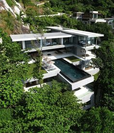 Nestled in rocks above Kamala Beach in Phuket, Thailand, you will find Villa Amanzi, the ultimate luxury getaway. Designed by Original Vision architects, this six-bedroom residence features a 50 ft (15m) infinity pool and breathtaking views over the Andaman Sea. I love the obvious influence of Frank Lloyd Wright's Fallingwater house on this cantilevered design!