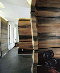 Certain parts of the home models and also incredible projects concepts demonstrates outstanding schein loft that has asymmetric design of coconut walls using traditional effect and also dark stitched leather longue seat and also gray marble floors