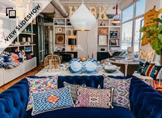 Navigating the city's new home-decor district #slideshow showing home boutique shops in Williamsburg | rich color statement sofas, exposed filament lightbulb shops, + coffee