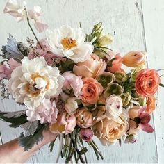 This colorful wedding bouquet filled with garden roses, posies, and pastel hues is perfect for a summer wedding! Click the link for more summer wedding flowers to include in your party this season. // Photo + Florals: Jenn Sanchez