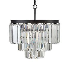 Do you find yourself torn between rustic practicality and glamorous embellishment? This chandelier combines the best of both styles, with a sturdy wrought iron frame supporting three dangling tiers of large crystals.