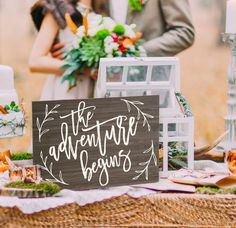 """This wooden sign is hand painted onto high quality, beautiful wood for your wedding reception or party decor. This wedding sign says """"The Adventure Begins"""" for a romantic and boho chic touch to your s"""